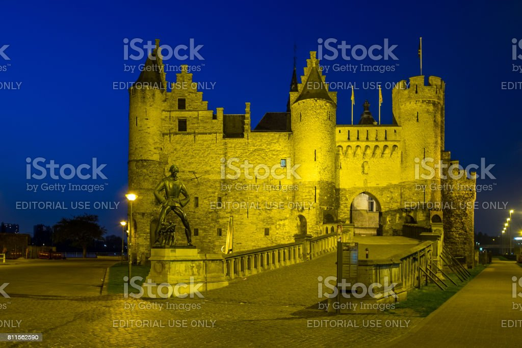 'Het Steen' fortress with the Lange Wapper monument during blue hour stock photo