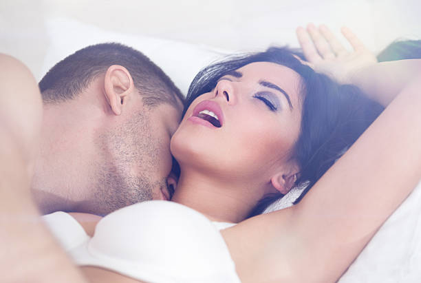 heterosexual couple having sex stock photo