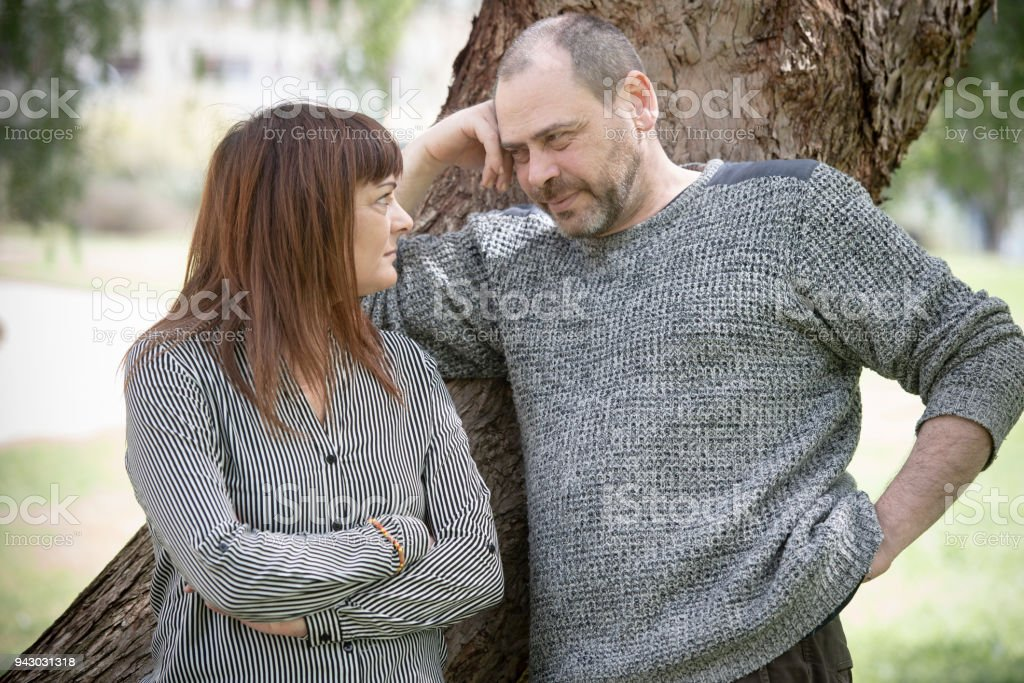 Heterosexual couple of adults at the park