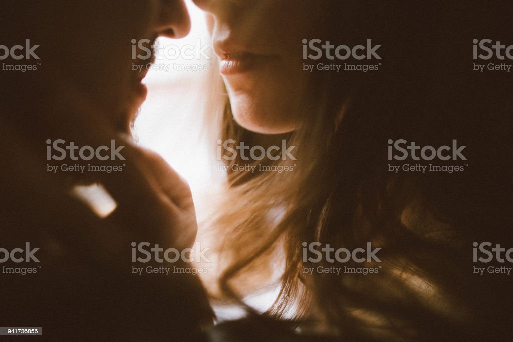 Heterosexual couple resting at home stock photo