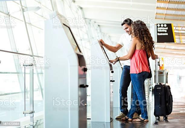 Heterosexual couple using quick checkin at airport picture id187420564?b=1&k=6&m=187420564&s=612x612&h=dz6tyebtosi1df9c4zpvm9d6o3aoonpn6ktm3 qgrl4=