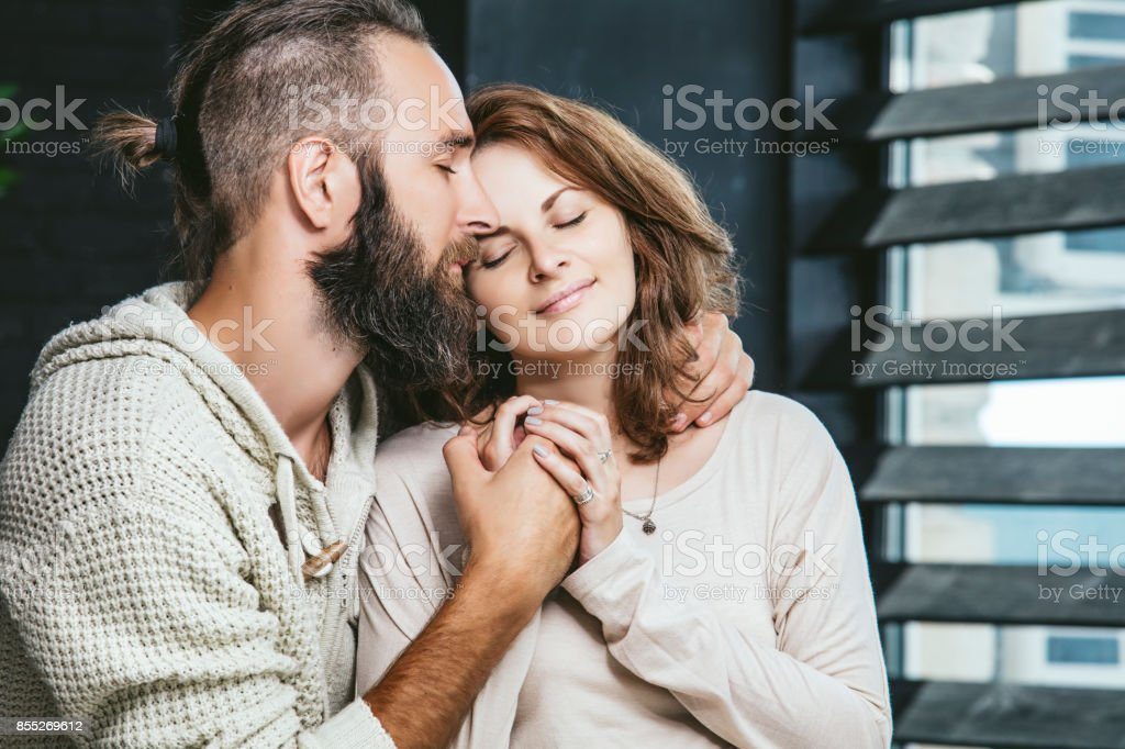 Heterosexual couples young beautiful man and woman on bed in bedroom...