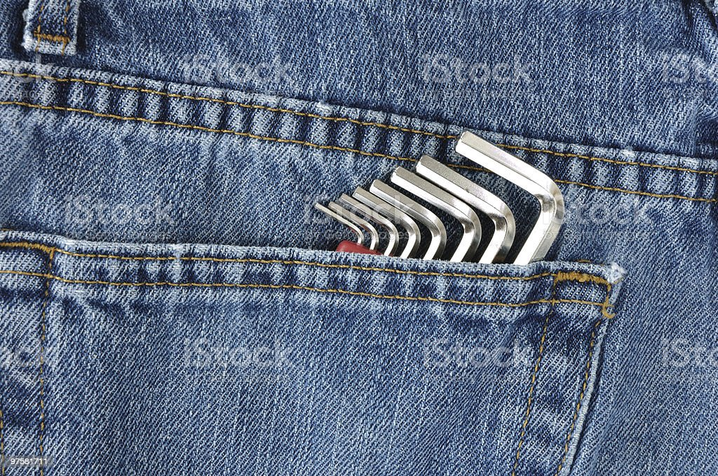 Hex Key Wrenches in Blue Jeans Pocket royalty-free stock photo