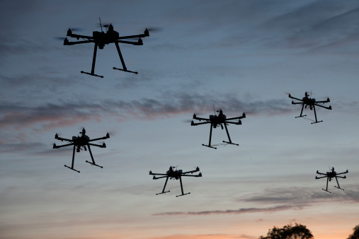 Hexacopter drones flying in the evening