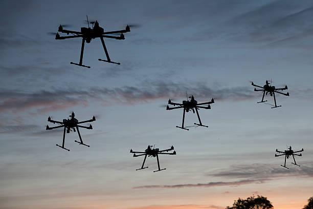 hexacopter drones flying stock photo