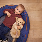 Little boy lying with his puppyhttp://195.154.178.81/DATA/i_collage/pi/shoots/783492.jpg