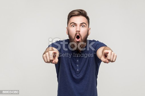 istock Hey you! Amazement bearded man pointing fingers at camera 888034380