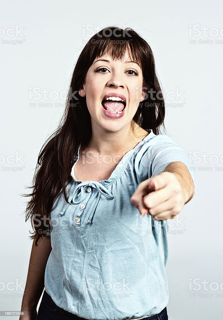 Hey you! Excited brunette points someone out royalty-free stock photo