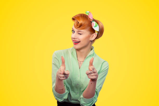 hey you! woman pointing index fingers gesture winking blinking eye - pin up girl stock pictures, royalty-free photos & images