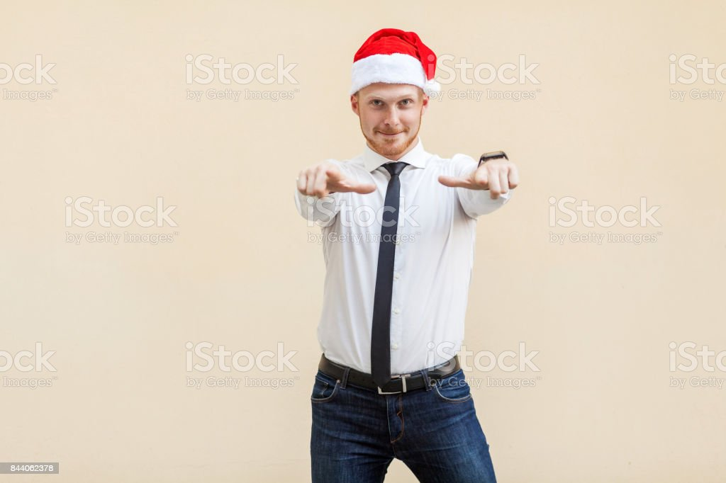 Hey you! Young adult red head bearded man, pointing finger and looking at camera. stock photo
