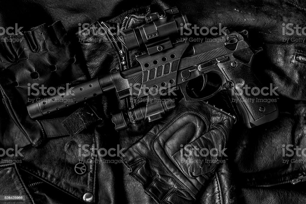 hi contrast leather and pistol stock photo