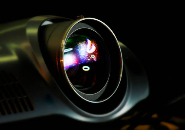 Hi tech Video Projector Detail of a Video Projector playing in dark room overhead projector stock pictures, royalty-free photos & images