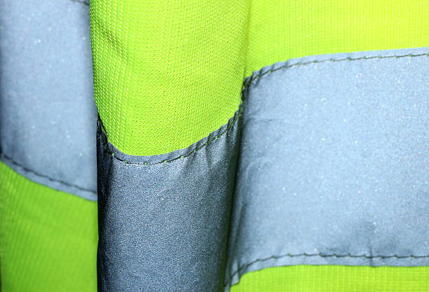 Hi Visibility Jacket Close Up Close up of a yellow hi visibility jacket. reflective clothing stock pictures, royalty-free photos & images