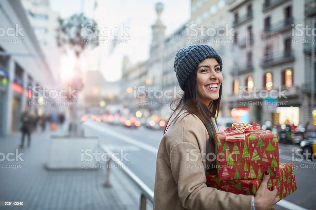 Hialing a taxi after some christmas shopping. stock photo