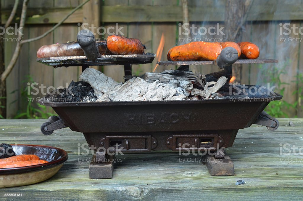 Flames In Hibachi Grill Cooking Meat On Picnic Table Pictures, Images And  Stock Photos