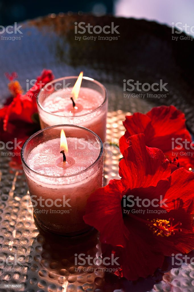 Hibiscus and candles royalty-free stock photo