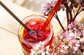 Hibiscus iced tea in a glass jar, close-up.