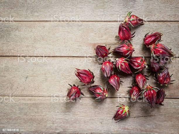 Hibiscus sabdariffa or roselle fruits on old wooden background picture id627661816?b=1&k=6&m=627661816&s=612x612&h=ms8dehap8kkv4jkew3tqkxziuyoxca9z34rf3bn0ryy=
