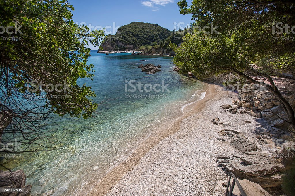 hidden beach in corfu greece stock photo