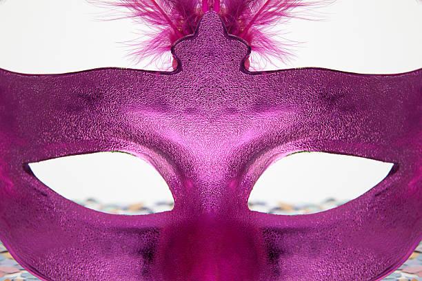 versteckt hinter einer maske - rosa camo party stock-fotos und bilder
