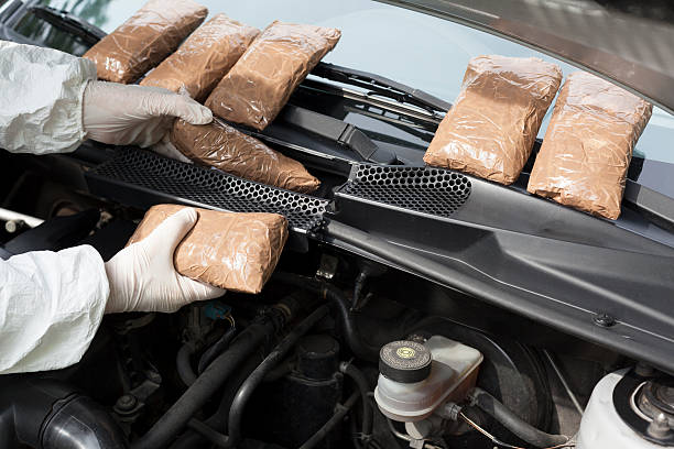 Hidden drugs in a vehicle compartment Drug smuggled in a car's engine compartment smuggling stock pictures, royalty-free photos & images