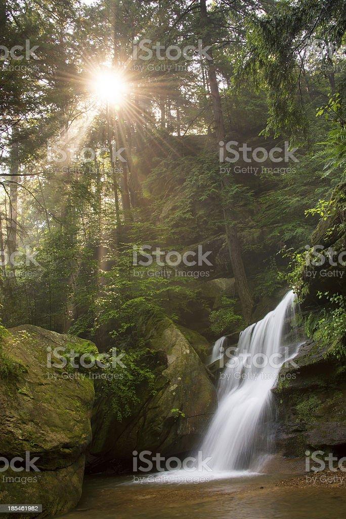 Hidden Falls and sunrays stock photo