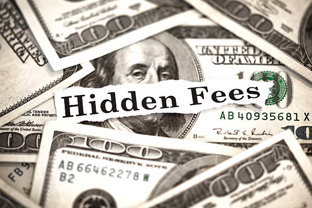 "Hidden Fees The words ""Hidden Fees"" with hundred dollar bills in the background. fee stock pictures, royalty-free photos & images"