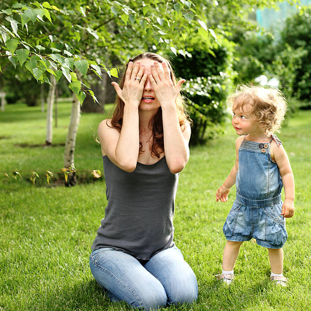 hide and seek - mom spying stock photos and pictures