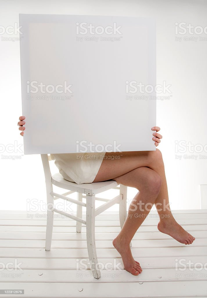 Hiding behind a frame royalty-free stock photo