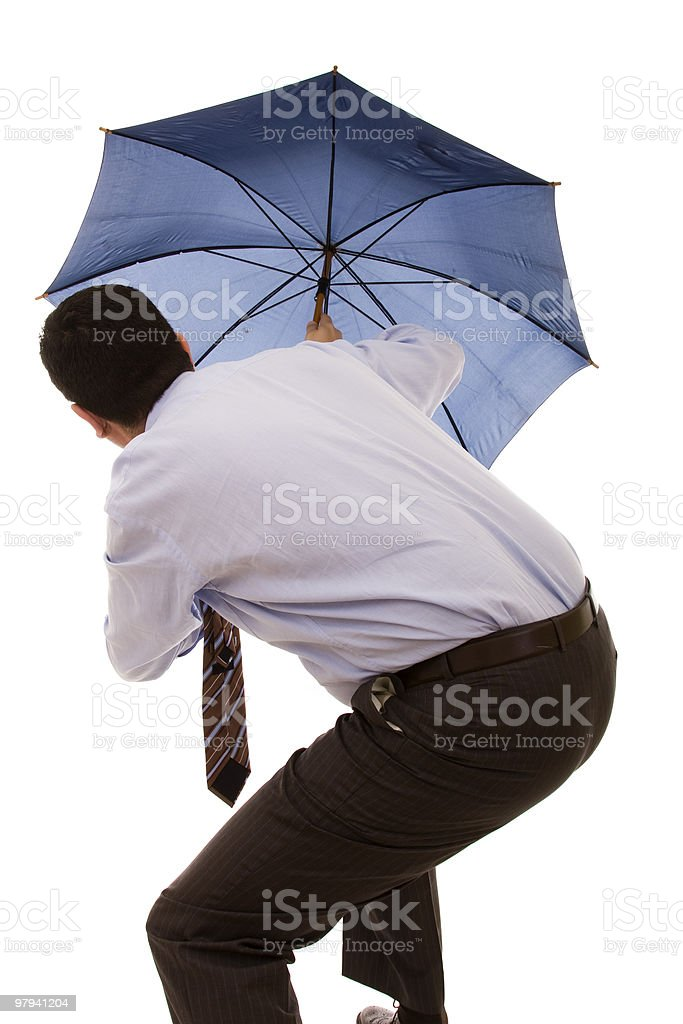 hiding bewind an umbrella royalty-free stock photo