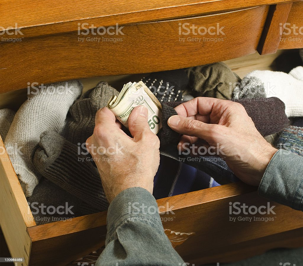 hiding cash in sock stock photo