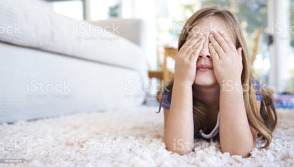 Hiding from mommy stock photo