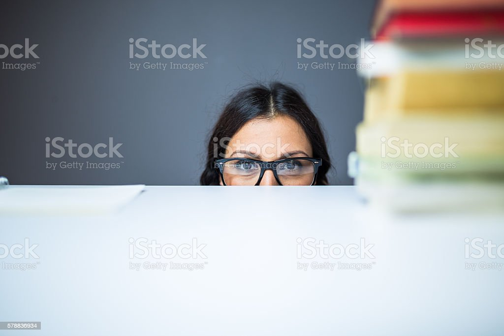 Hiding from the boss at the office stock photo