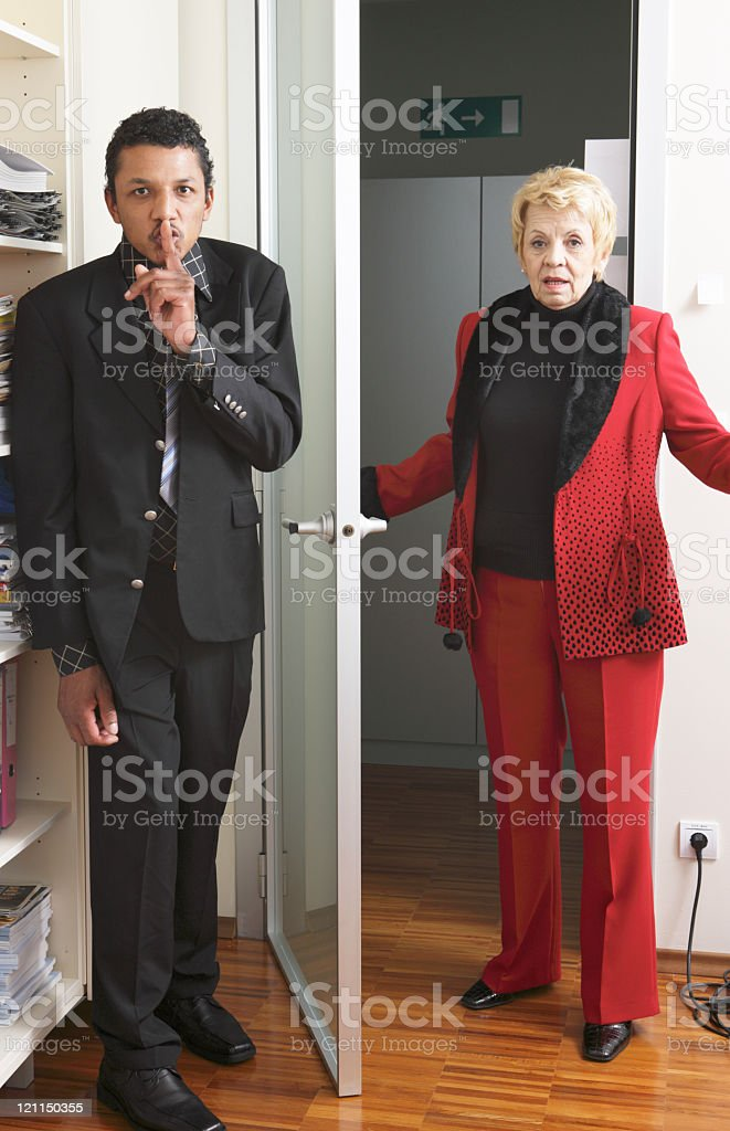 Hiding from the boss stock photo