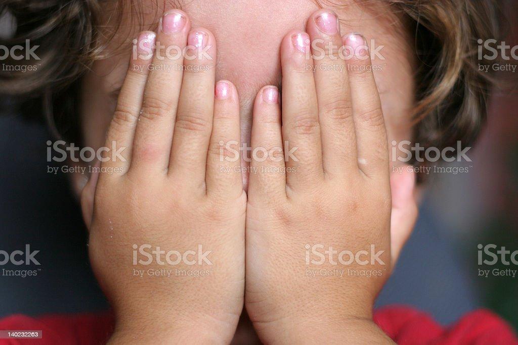 Hiding girl 2 stock photo