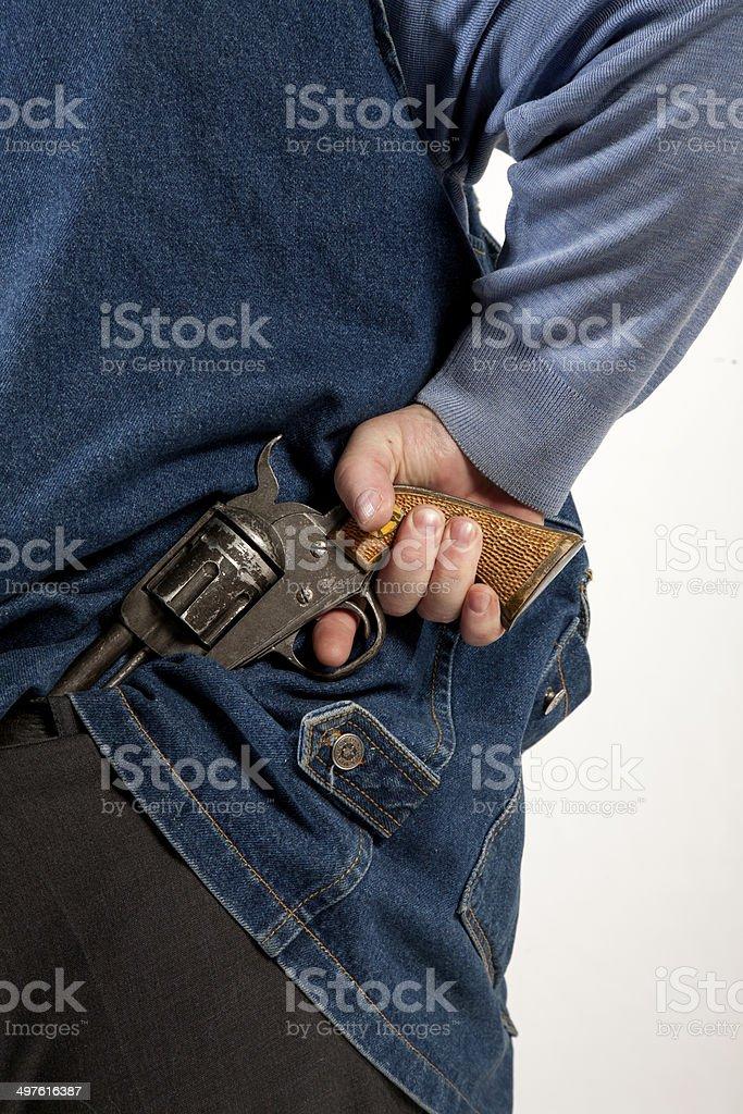 Hiding gun royalty-free stock photo