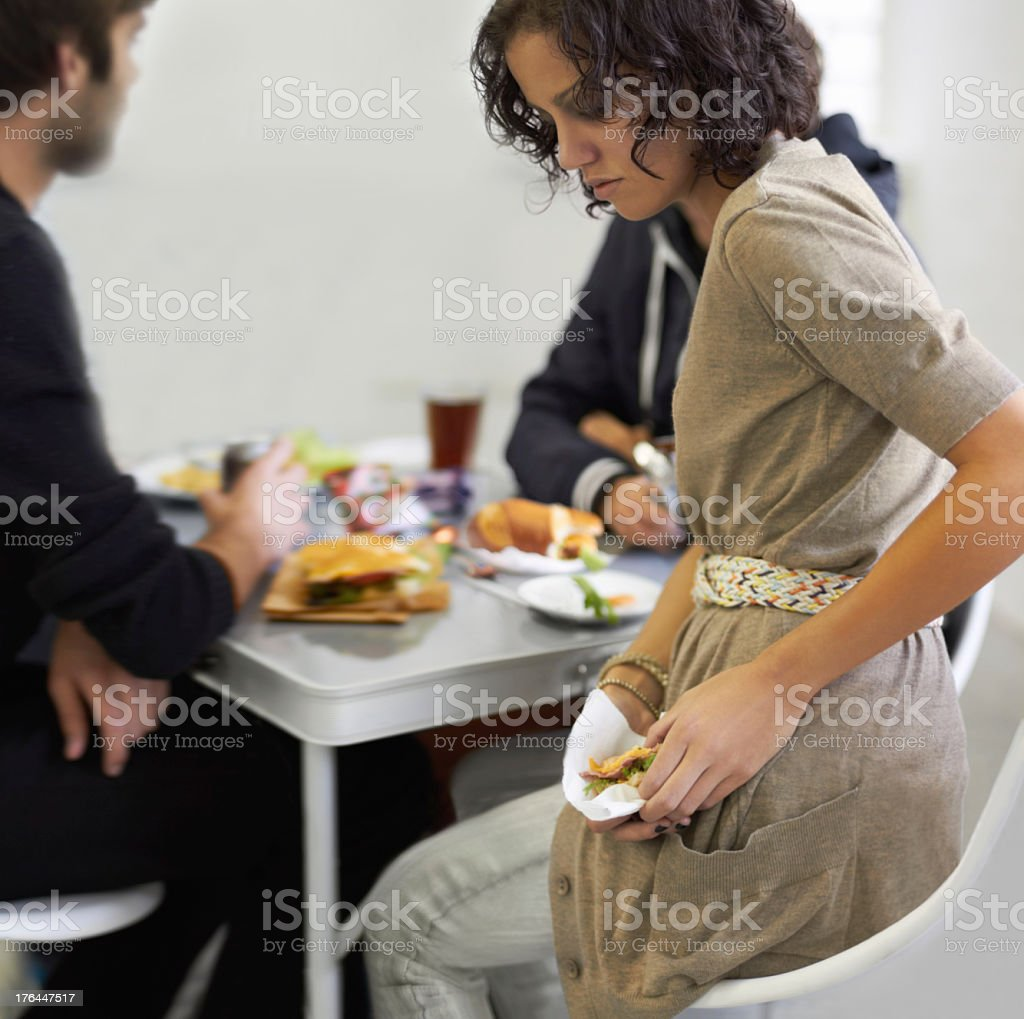 Hiding her eating disorder stock photo