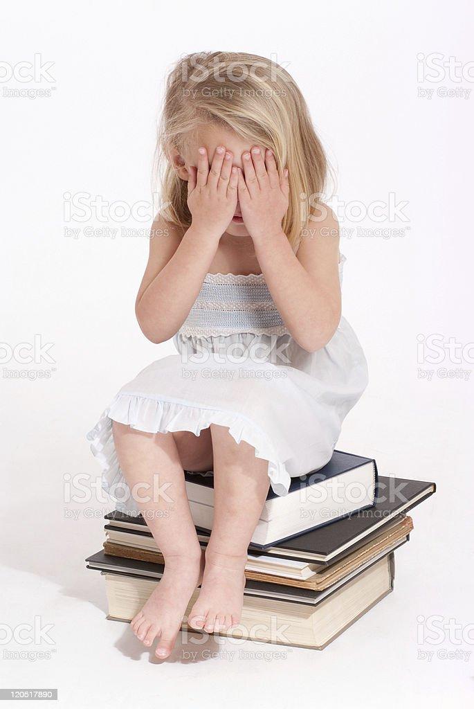 Hiding little girl stock photo