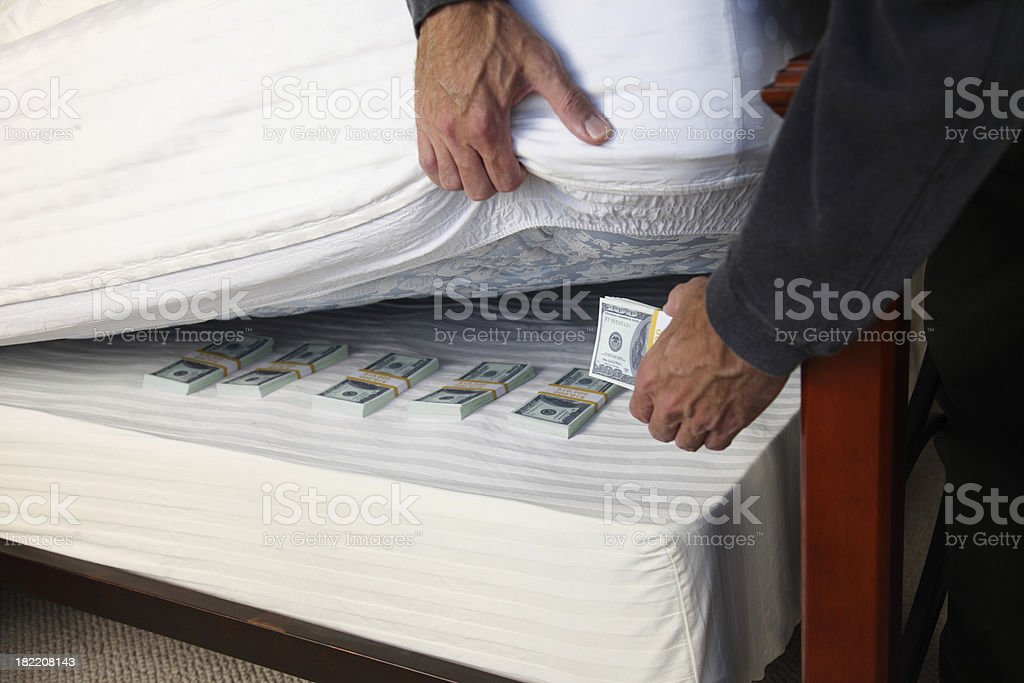 Hiding Money Under The Mattress stock photo