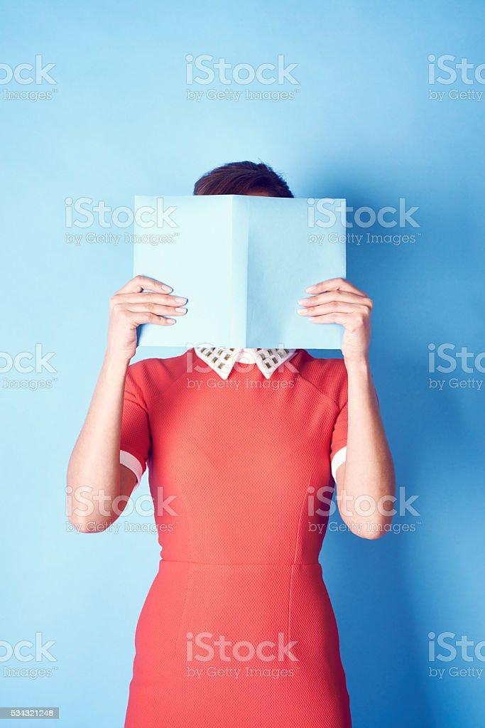 Hiding the face stock photo