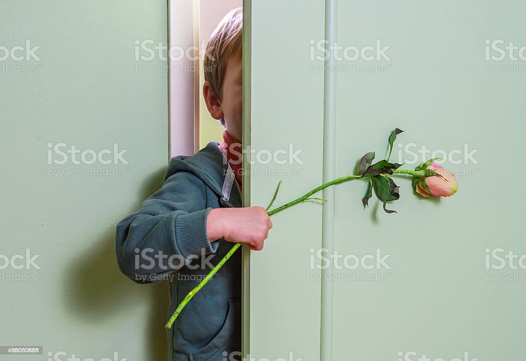 Hiding with flower stock photo