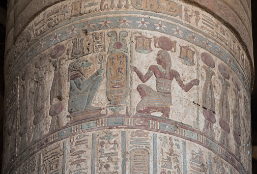 Hieroglyphic carvings on an ancient egyptian temple column