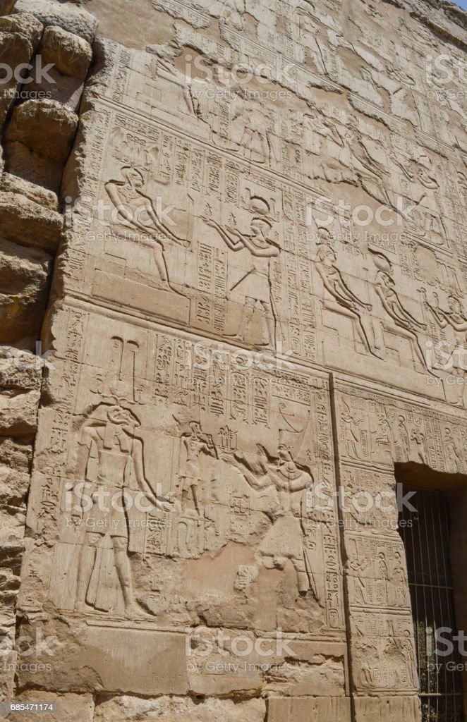 Hieroglyphic carvings on an ancient egyptian temple wall stock photo