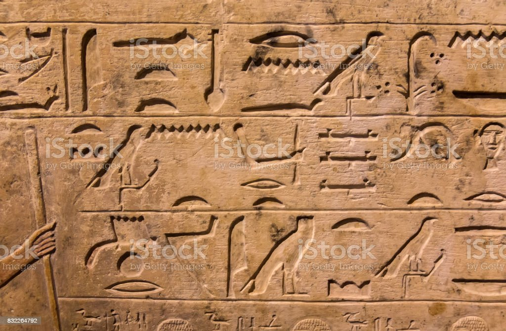 Hieroglyphic carvings on the exterior walls of an ancient egyptian temple stock photo