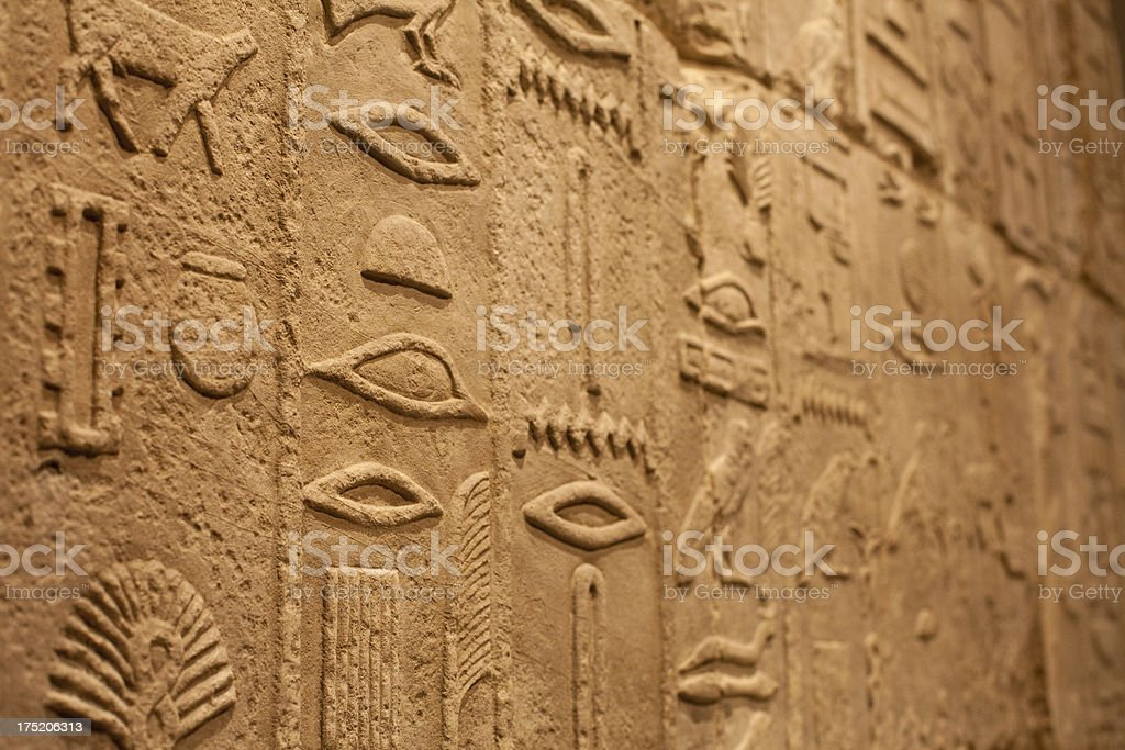 Hieroglyphics carved in stone royalty-free stock photo