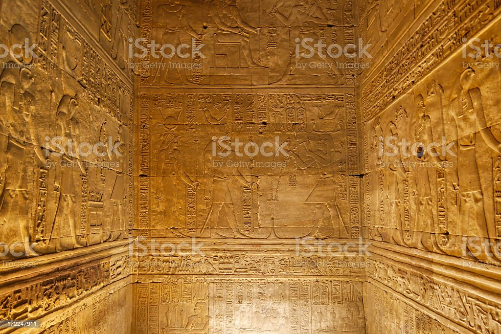 Hieroglyphics on ancient chamber walls stock photo
