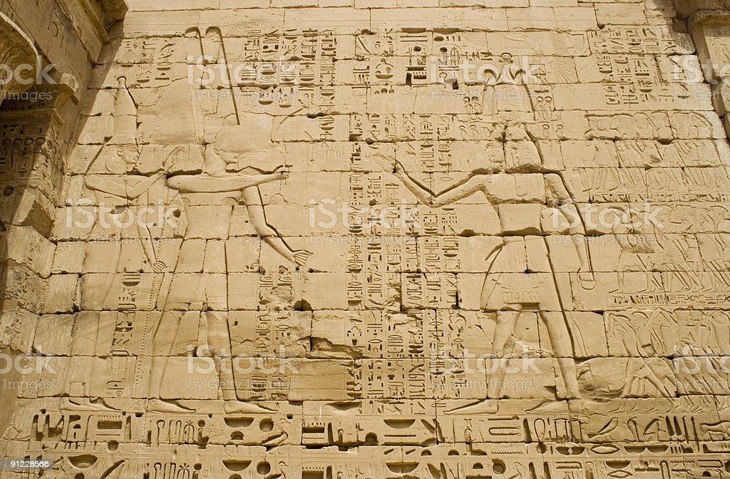 Hieroglyphics on ancient temple wall at Medinet Habu stock photo