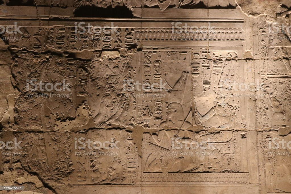 Hieroglyphs damaged by Copts and covered with Fresco at Temple of Luxor stock photo
