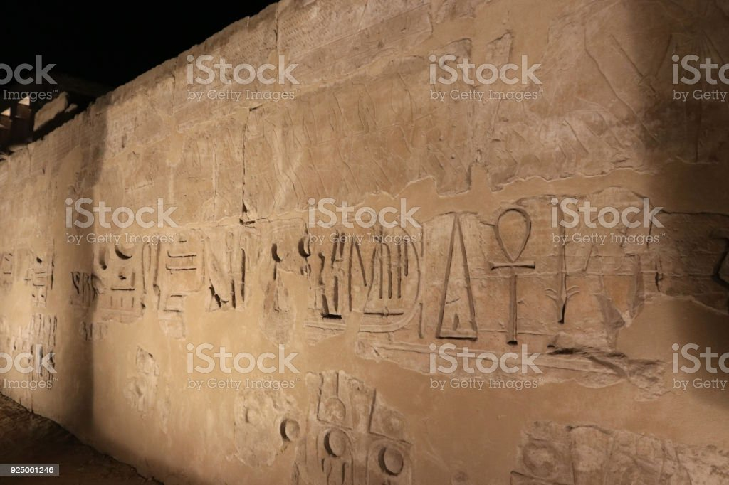 Hieroglyphs on the wall of Luxor temple stock photo