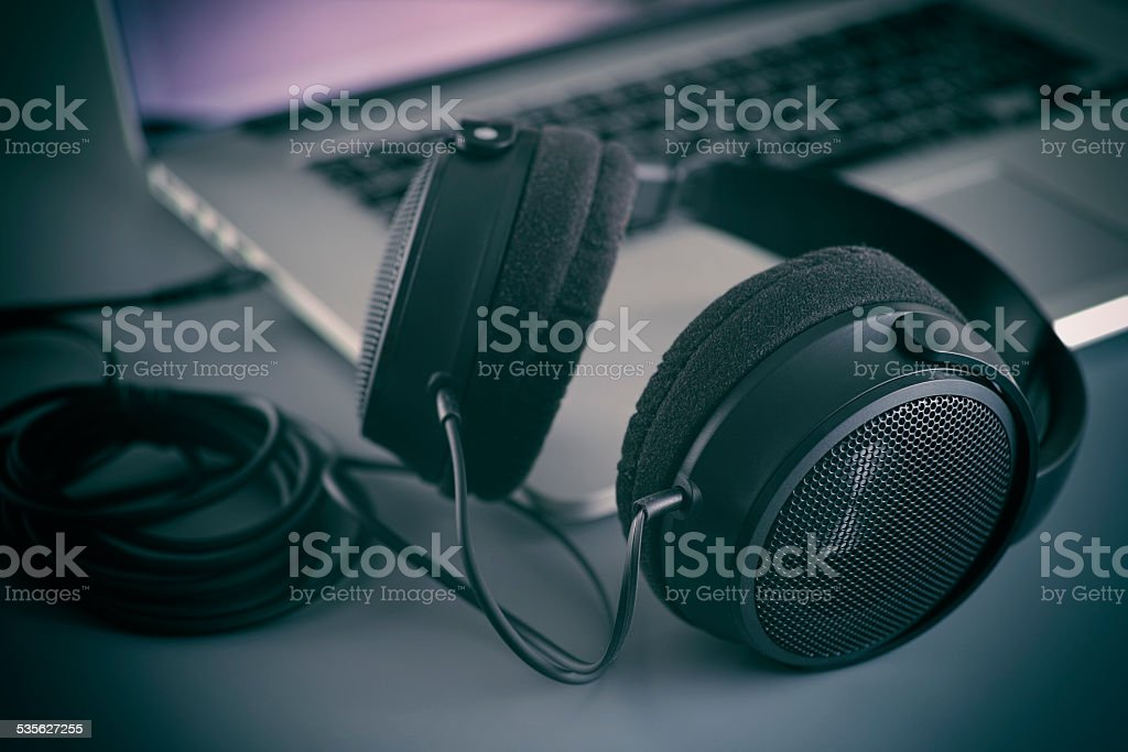 Hi-Fi headphones on a laptop in the studio stock photo